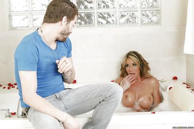 Busty cougar Farrah Dahl masturbating in bathtub and sucking big cock
