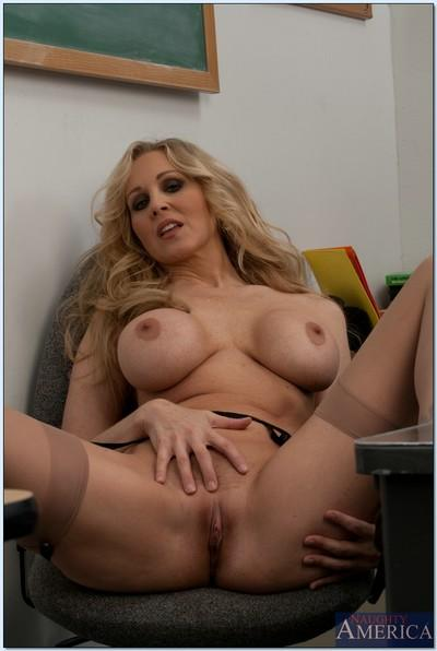 MILF teacher babe Julia Ann shows her amazing body in the classroom