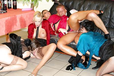 Fully clothed MILFs with hot bodies enjoy a fervent pissing orgy