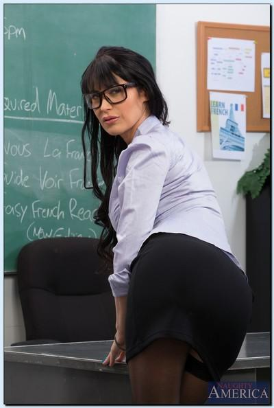 Sexy teacher in glasses Eva Karera getting naked in the classroom