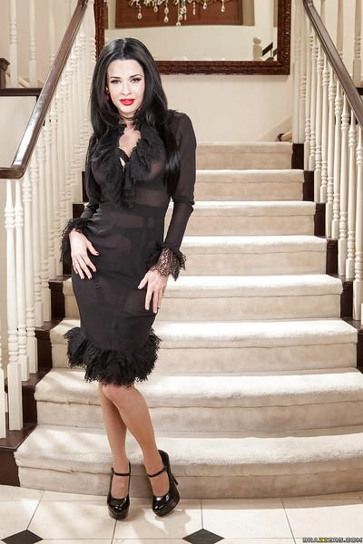 Raven-haired MILF in stockings undressing and spreading her legs