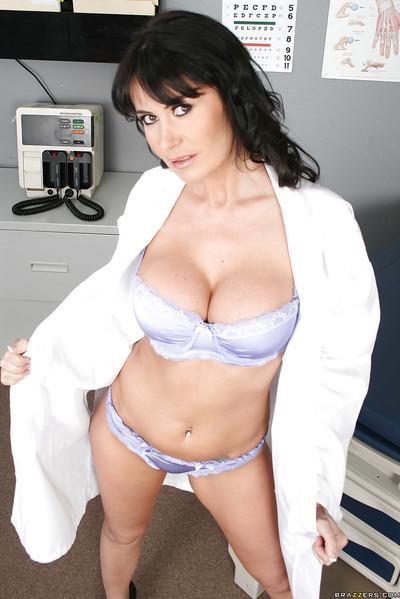 Amazing MILF Eva Karera with big tits takes off her doctor