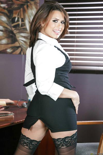 Cute Latina MILF Eva Angelina posing nude in black stockings at work