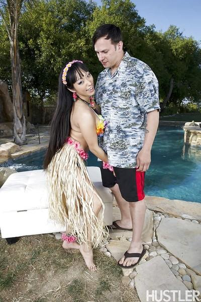 Busty Asian MILF Gaia blowing a white dude beside swimming pool