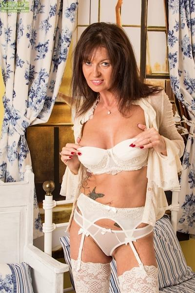 Stockings model Lucy Heart is taking off her favorite underwear