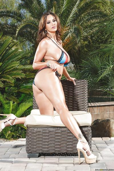 Curvy mom Ava Addams posing in bikini and high heels outdoors