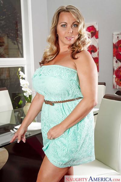 Cougar Milf Amber Lynn Bach unleashing her massively huge tits
