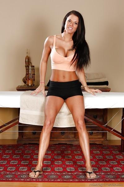 Leggy brunette Peta Jensen shows off her big boobies and ass