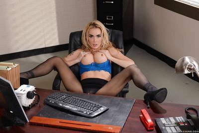 Blonde busty office MILF Devon showing off her legs in stockings