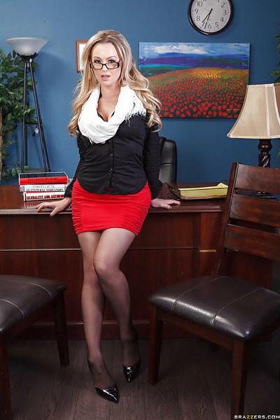 Busty teacher in glasses Abbey Brooks taking off her suit and lingerie