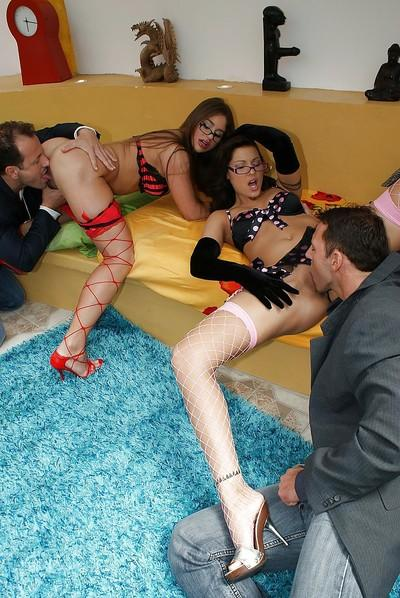 Glamorous sluts in glasses and fishnets enjoy foursome with hung lads