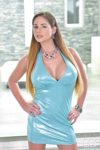 Busty Euro babe Cathy Heaven posing fully clothed in blue dress