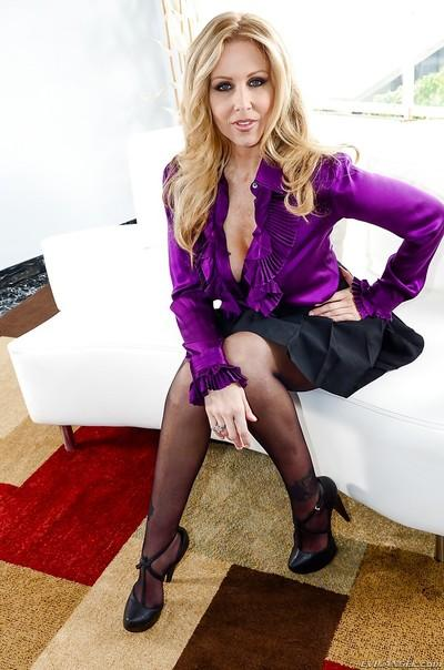 Milf pornstar Julia Ann is playing with this pretty big rubber dick
