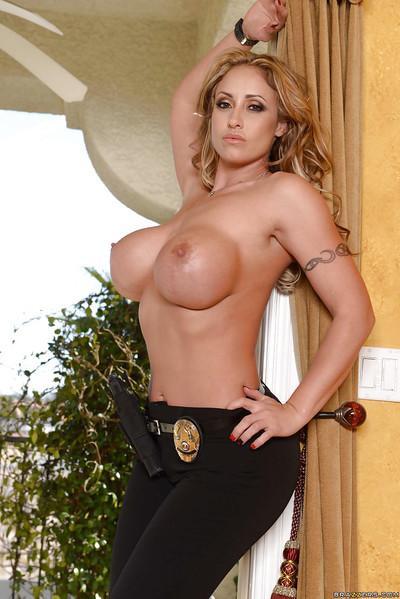 Top heavy blonde MILF Eva Notty spreading hose covered legs