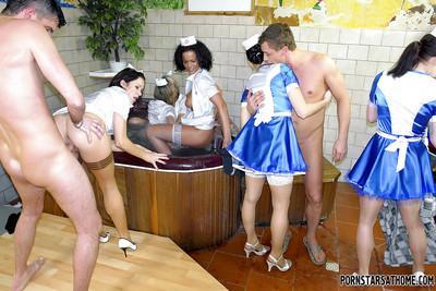 Lecherous MILFs in sexy nurse uniforms enjoy a wild CFNM groupsex