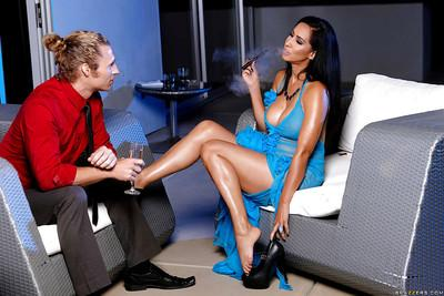 Brunette cougar Isis Love smokes a cigar while giving blowjob