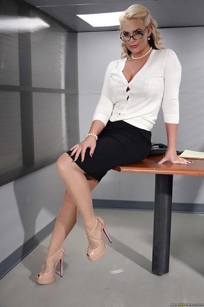 Hot blonde secretary in glasses and black skirt strips naked