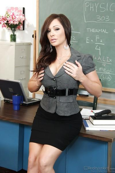 Stunning teacher in dress clothes revealing her goods in the classroom