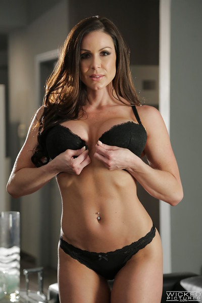MILF pornstar Kendra Lust erotic dance nude to flaunt big whoppers and butt