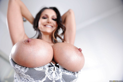 Breasty MILF Ava Addams lets her huge hooters loose from business clothing