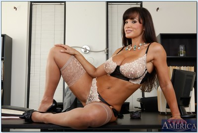 Comely MILF in  Lisa Ann exposing fabulous butt and bazookas