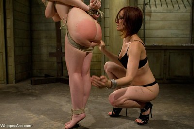 Babe gets fastened and anal screwed by kinky lesbian domina