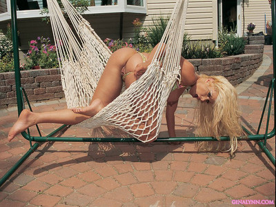 Fairy hottie gina lynn removes clothes in advance of oiling up and posing for the live camera on the c