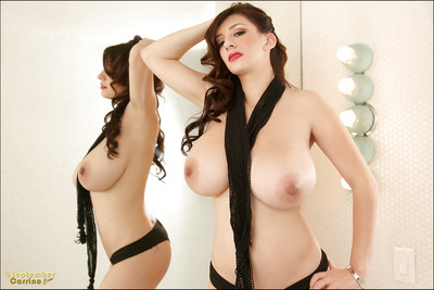 Curvaceous angel with big tits September Carrino posing topless