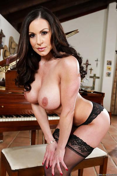 Buxom brunette MILF Kendra Lust posing solo in black  and heels