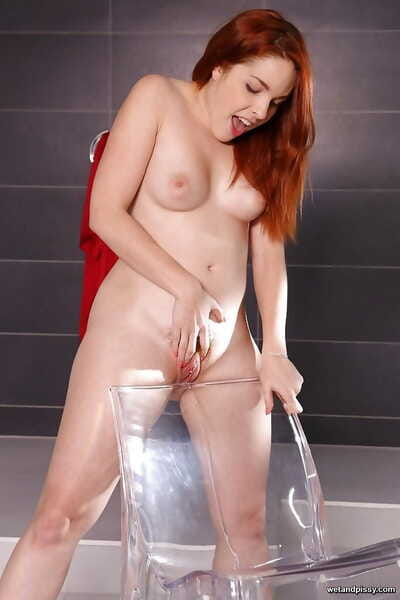 Redheaded European solo girl Amarna Miller licking own pee right after pissing