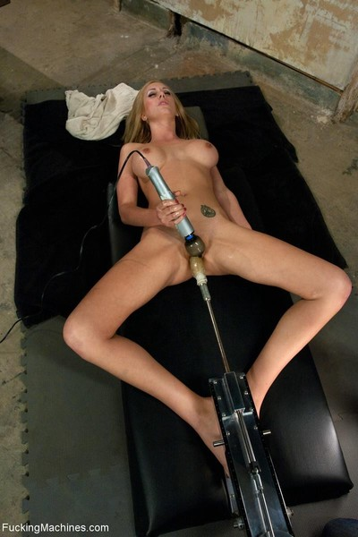 Untamed enormous titted cutie gets dug by dildo machine in locker room