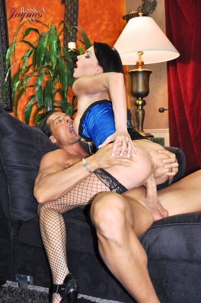 Jessica jaymes in a blue corset and fishnet stockings accepts fucked hard