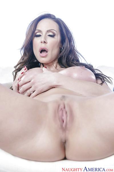 Brunette MILF model Kendra Lust freeing big tits and apple bottoms from bikini