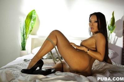 Japanese pornstar asa akira posing on her daybed