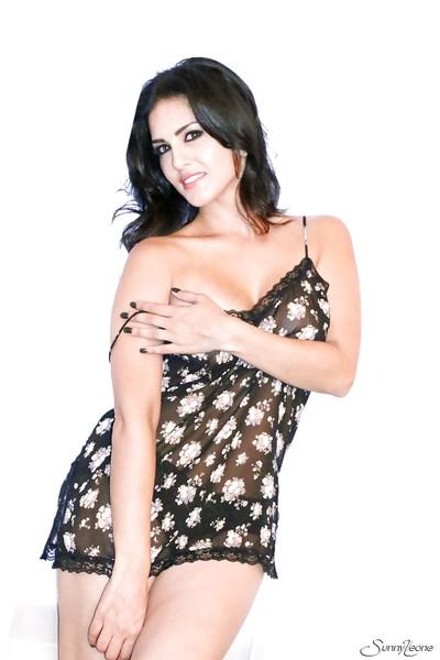Milf brunette Charming Leone is posing spectacular elegant in her lingerie