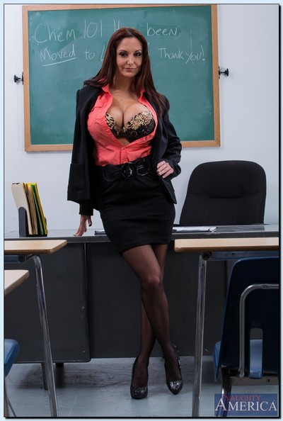 Sweaty educator Ava Addams gets rid of her formal suit and exposes her gigantic tits