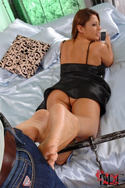 Alison star rubs a massive rod with her sexy feet in mattress