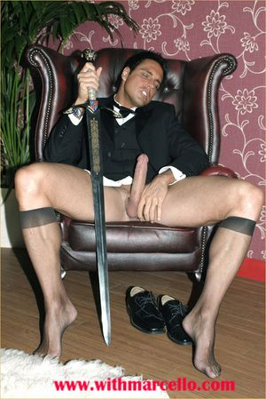 Marcello smoking a cigar in his tuxedo and then fretting his hard dick