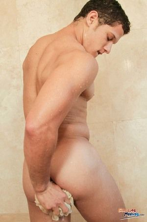 Hunky Nicoli goes for a shower and gets horny. He plays his cock to full erection and inserts a sex toy in his ass. He likes this nasty pleasure a lot.
