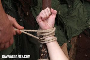 Vitaly gets tied to a metal bar and he has to suck stay away from the soldiers. They accumulate a rope around his cock and balls and humiliate and torture him Then the exhausted boy has to perform exercises.