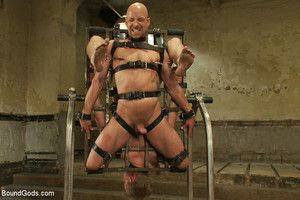 Two studly slaves gets tied up, used together with abused by Christian Wilde during a live show.