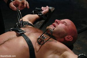 Muscle boy endures wax torment, electricity and a headless fuck by his dom Leo Forte.