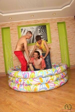 Dark-skinned haired guy drunken on in the indoor pool