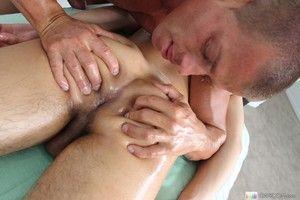 Cheerful masseur hitting her high horse customer