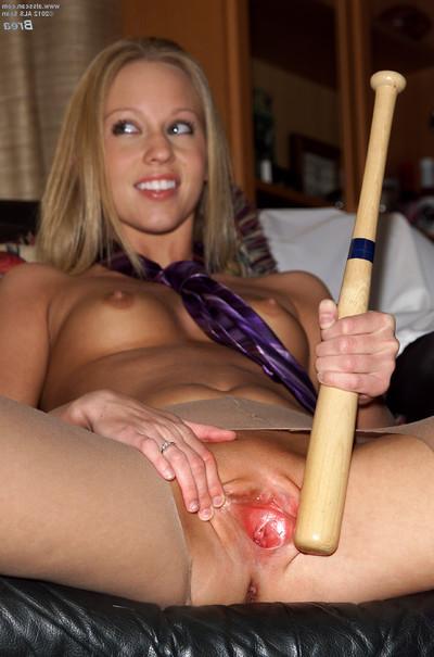 Extreme brea bennett plays with a baseball bat