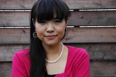 Asian young Nao Kodaka undressing and widening her twat lips