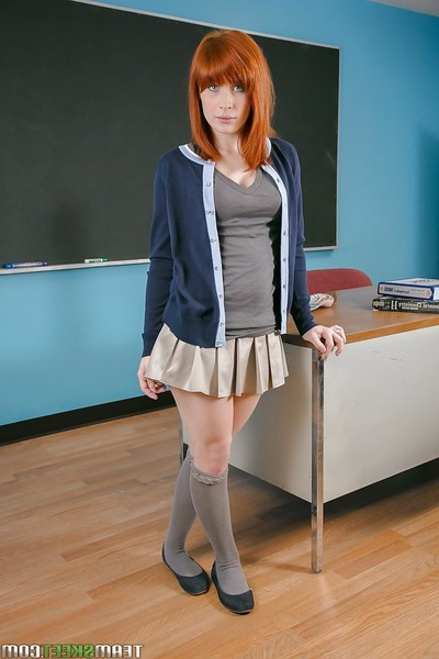 Schoolgirl redhead Sadie undressing her lingerie to show these boobs