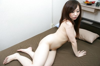 Unclothed asian young Rie Noguchi has some cage of love fingering and toying getting pleasure