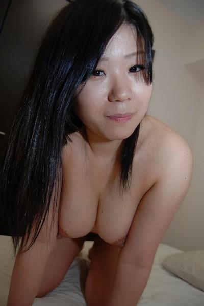 Eastern juvenile Natsuki Arai striping down and stretching her lower lips