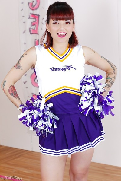 Tattooed schoolgirl cheerleader stripped off for shaved pussy amplifying